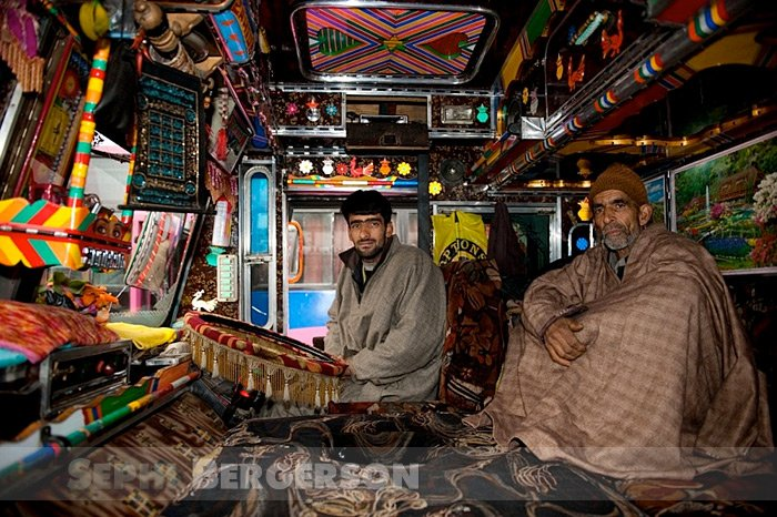Kashmiri truck drivers in the cabin of their truck. Drivers spend weeks at a time on the road and deck the truck as fully as they can to make the journy as comfortable as possible