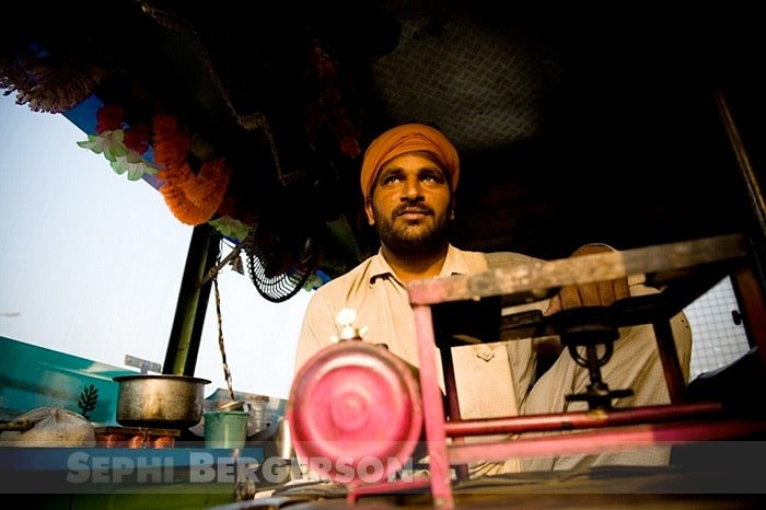 A driver about to start making dinner in the cabin of his truck. Punjab