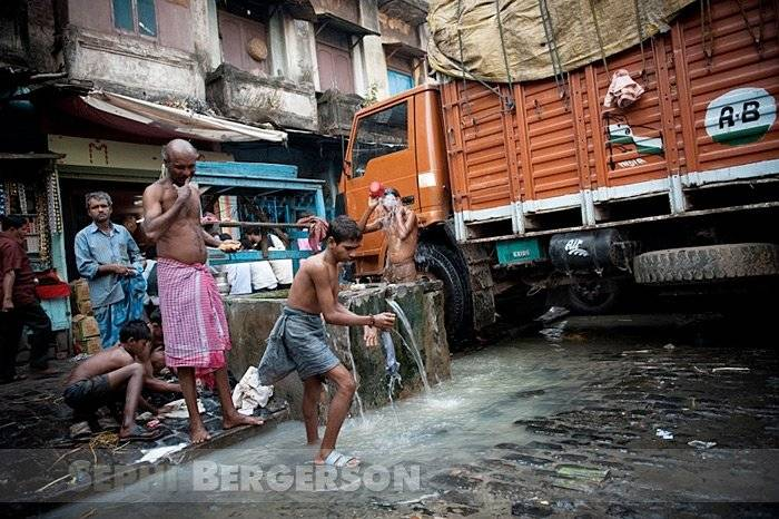 Drivers go about their morning duties in a Kolkata market