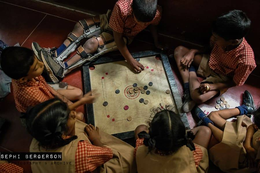 Disabled children at APD School in Bangalore play a game of Karam in one of the class rooms.